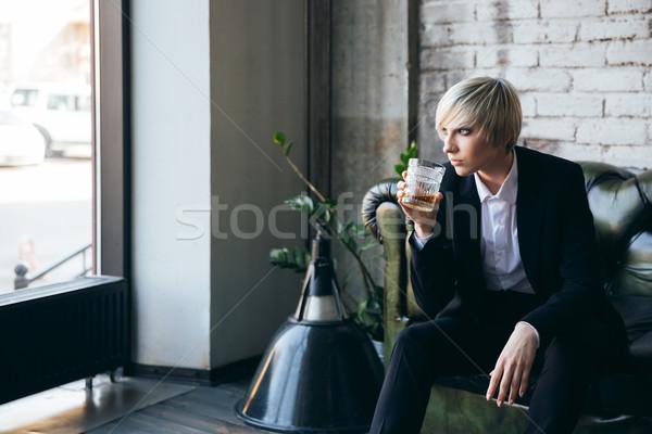 Elegante menina potável álcool café Foto stock © deandrobot