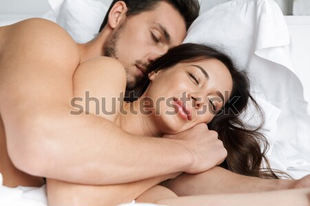 Close-up portrait of a happy couple sleeping and hugging Stock photo © deandrobot