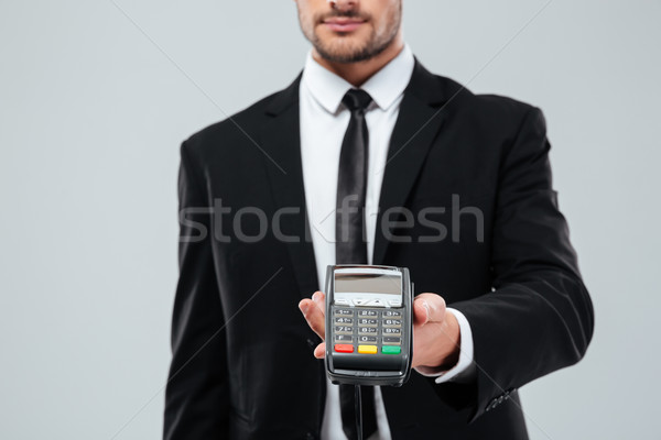 Jóképű fiatal üzletember fizetés közelkép üzlet Stock fotó © deandrobot