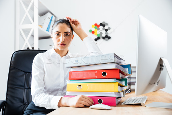 Exhausted tired businesswoman sitting at the office desk Stock photo © deandrobot