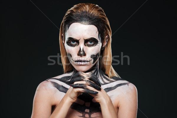 Kobieta przerażający szkielet makijaż czarny kwiat Zdjęcia stock © deandrobot
