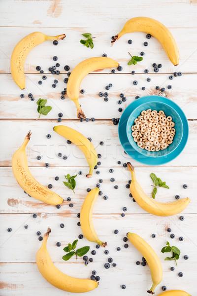 Haut vue bol céréales bananes baies Photo stock © deandrobot