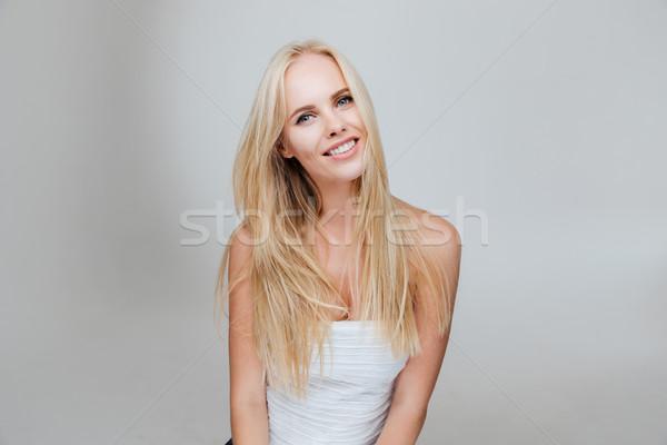 Portret gelukkig mooie jonge vrouw blond haar grijs Stockfoto © deandrobot