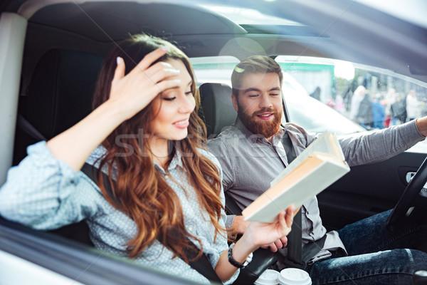 Boldog pár autó oldalnézet lány olvas Stock fotó © deandrobot
