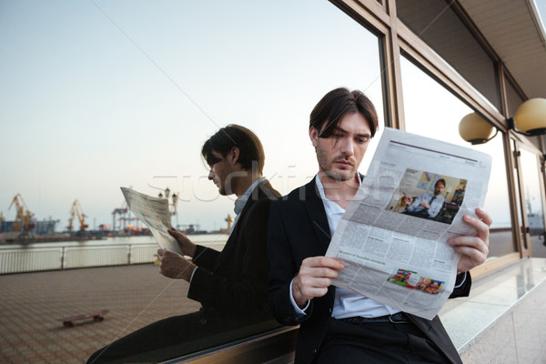 Man in suit with newspaper Stock photo © deandrobot