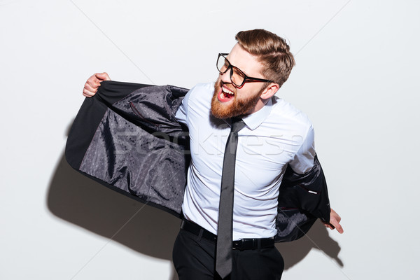 Business man in glasses and suit Stock photo © deandrobot