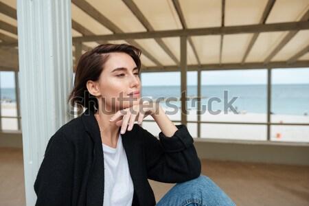 Happy woman sitting in gazebo on the beach Stock photo © deandrobot