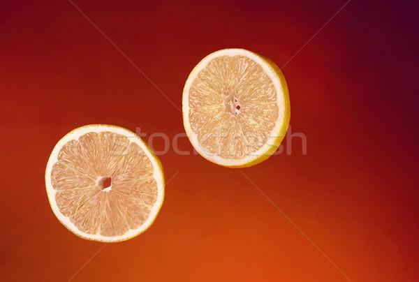 Deux tranches fraîches orange isolé rouge Photo stock © deandrobot