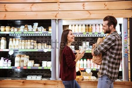 ストックフォト: カップル · 買い · ミルク · 食料品 · ショップ · 幸せ