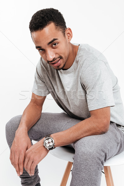 Attractive young dark skinned man Stock photo © deandrobot