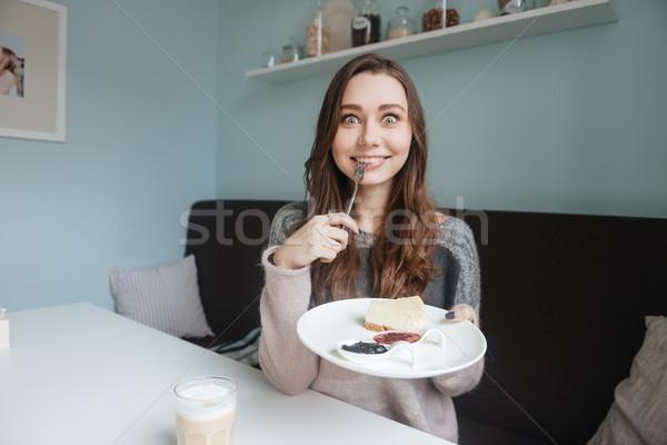 çılgın genç aç bayan oturma kafe Stok fotoğraf © deandrobot