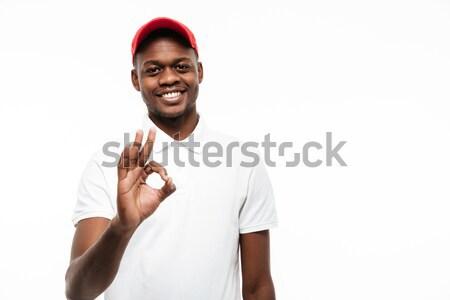 Alegre jovem africano homem boné Foto stock © deandrobot