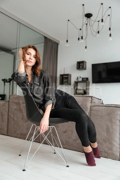удивительный женщину сидят стул домой Сток-фото © deandrobot