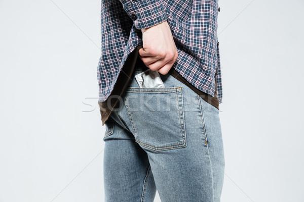 Kép hipszter fektet óvszer hát zseb Stock fotó © deandrobot