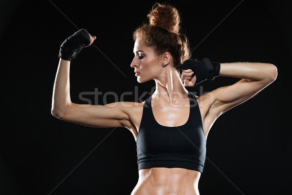 Serious female fighter showing her biceps Stock photo © deandrobot