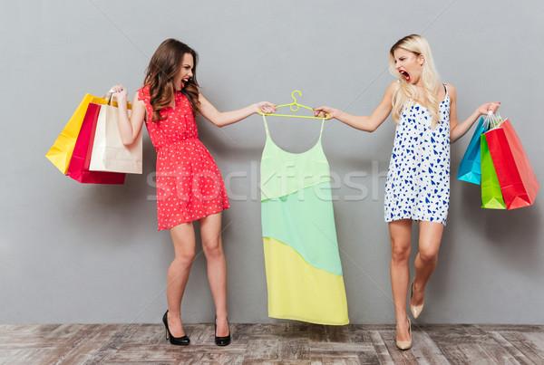 женщины разделение платье два молодые сердиться Сток-фото © deandrobot