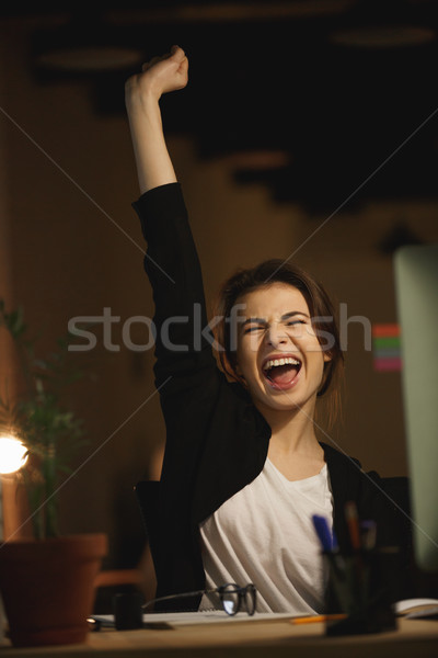 Yawning young lady designer sitting in office at night Stock photo © deandrobot