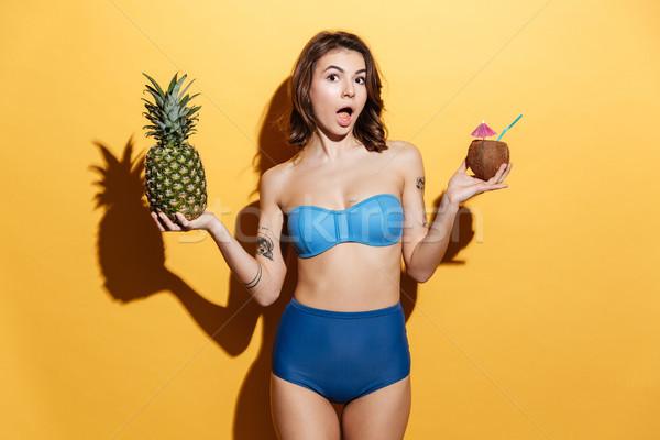 удивленный девушки купальник ананаса кокосового Сток-фото © deandrobot