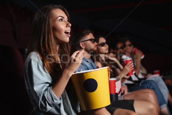 Boldog barátok ül mozi óra film Stock fotó © deandrobot