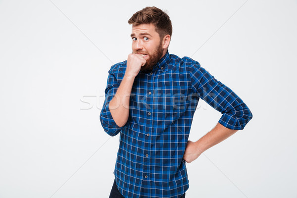 Scared man looking camera and don't know what to do Stock photo © deandrobot