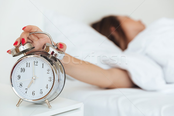 Close up portrait of a woman in bed Stock photo © deandrobot