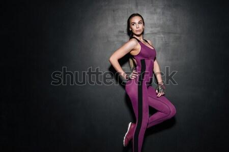 Fiatal nő sportruha pózol néz váll portré Stock fotó © deandrobot