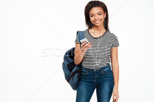 Fiatal afrikai lány diák hátizsák hallgat Stock fotó © deandrobot