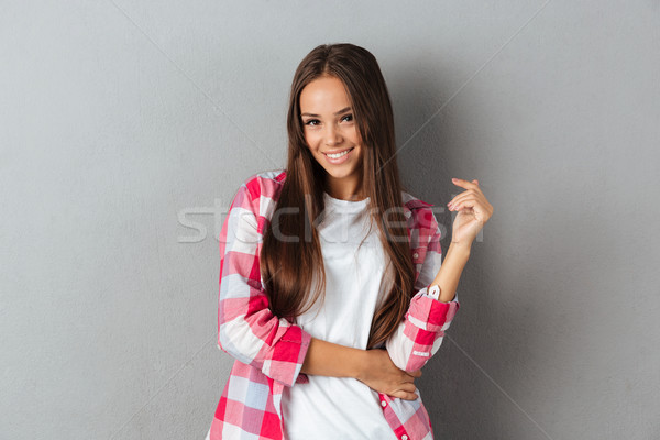Close-up photo of beautiful young brunette woman in checkered sh Stock photo © deandrobot