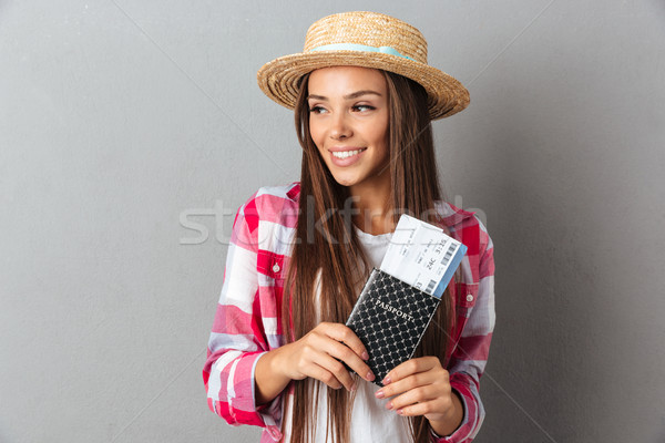 Close up portrait of a smiling happy woman traveller in straw ha Stock photo © deandrobot