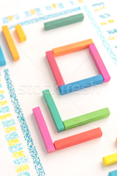 Cropped photo of a cute geometric pattern made of colorful kid's Stock photo © deandrobot