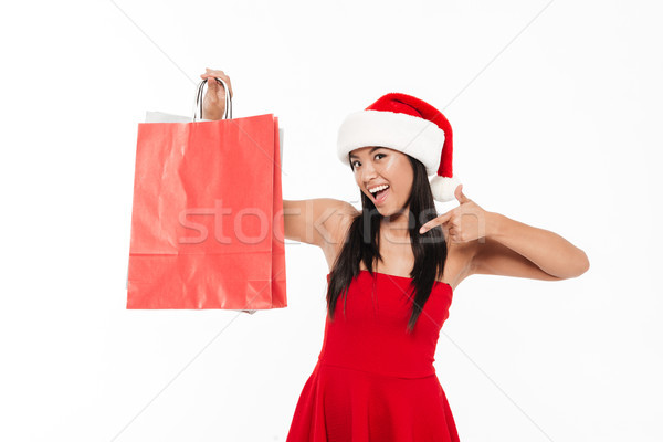 Stock photo: Portrait of a pretty excited young asian woman