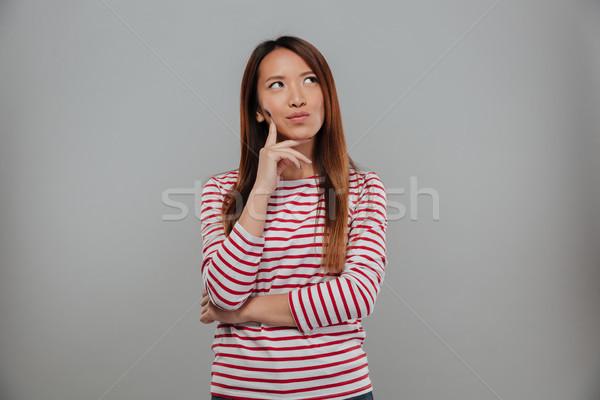 Zdjęcie zamyślony asian kobieta sweter Zdjęcia stock © deandrobot