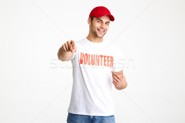 Portrait of a happy cheerful man wearing volunteer t-shirt Stock photo © deandrobot
