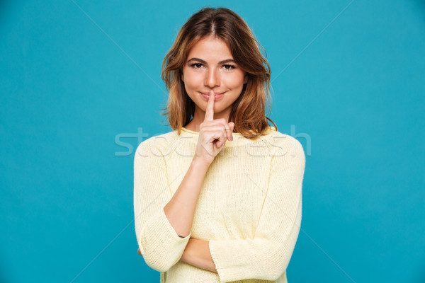 удивительный молодые улыбающаяся женщина молчание жест Сток-фото © deandrobot