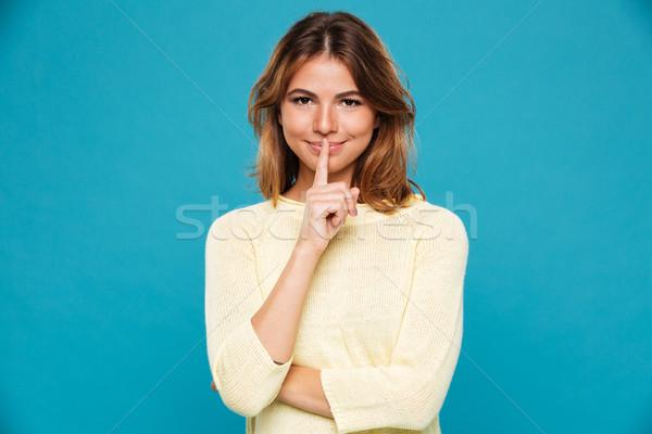 Incroyable jeunes femme souriante silence geste Photo stock © deandrobot