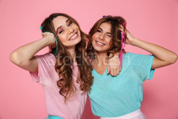 Close-up portrait of two smiling woman dressed like children tou Stock photo © deandrobot