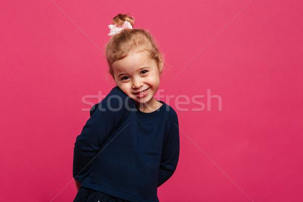 Utangaç genç kız poz stüdyo bakıyor kamera Stok fotoğraf © deandrobot