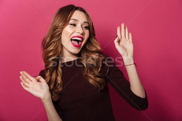 Boldog hölgy áll izolált rózsaszín kép Stock fotó © deandrobot