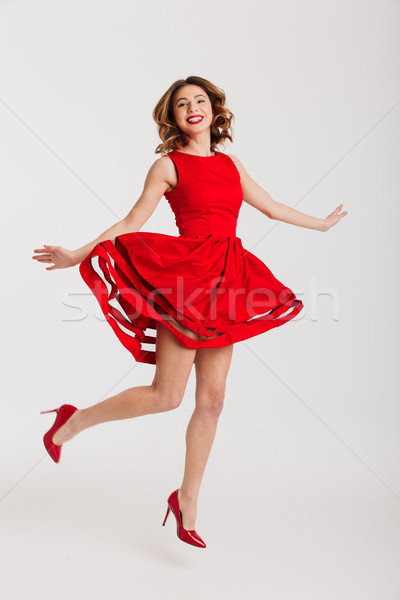 Portrait heureux fille robe rouge posant Photo stock © deandrobot