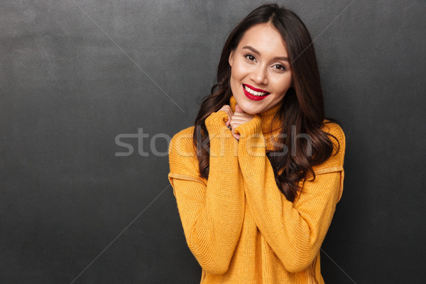 Pretty smiling brunette woman posing and looking at the camera Stock photo © deandrobot