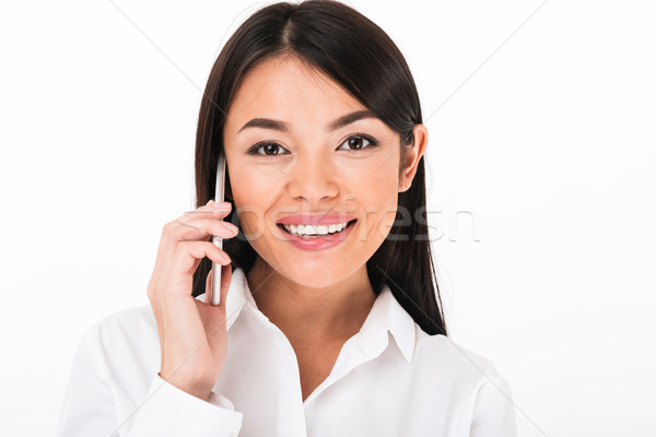Close up portrait of a smiling asian businesswoman Stock photo © deandrobot