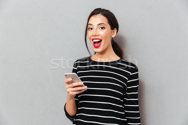 肖像 満足した 女性 携帯電話 見える ストックフォト © deandrobot