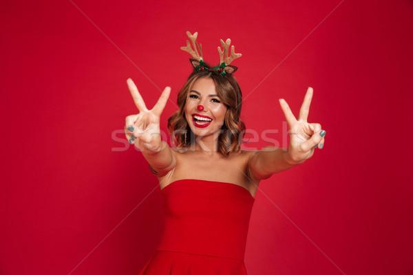 Portrait of a joyful happy girl wearing christmas deer costume Stock photo © deandrobot