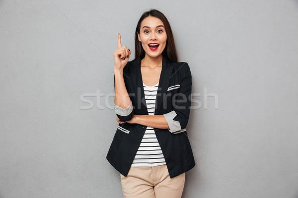 удивленный счастливым азиатских деловой женщины Идея глядя Сток-фото © deandrobot