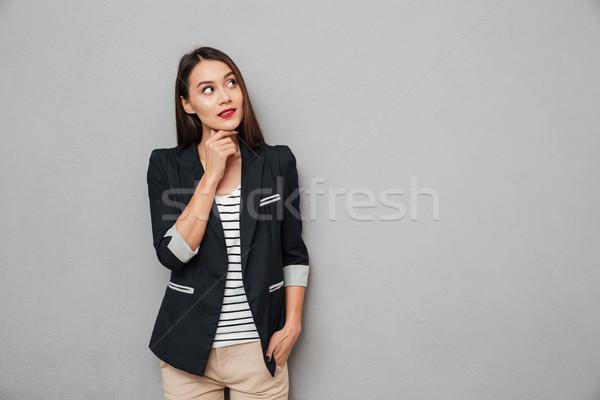 Zamyślony asian business woman ramię kieszeni Zdjęcia stock © deandrobot