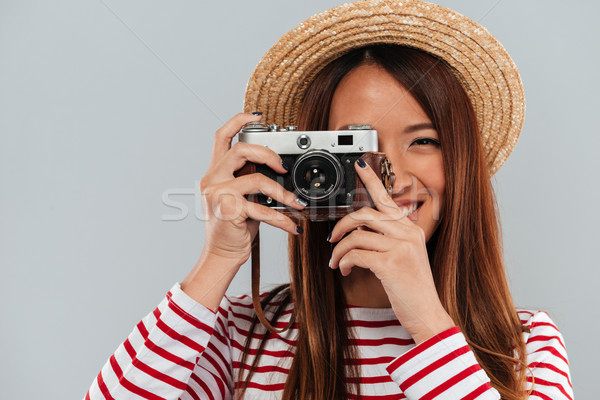 Close up image of carefree asian woman in sweater Stock photo © deandrobot
