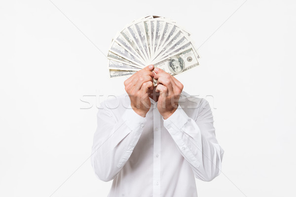 Portrait of a man in white shirt hiding Stock photo © deandrobot