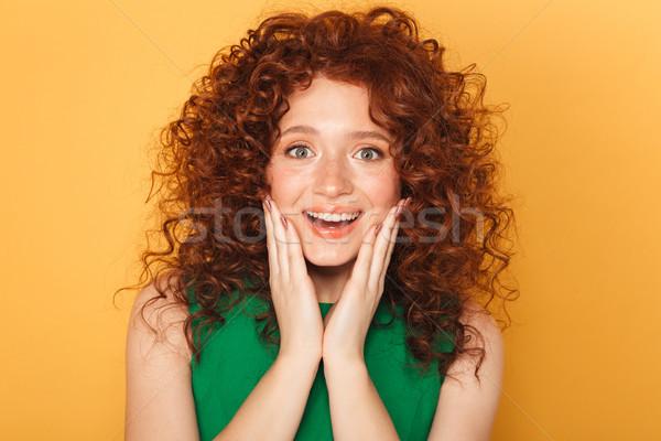 Közelkép portré izgatott fürtös vörös hajú nő nő Stock fotó © deandrobot