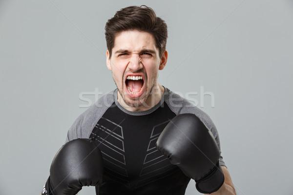 Sikít érzelmes fiatal sportoló boxoló kép Stock fotó © deandrobot