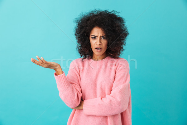 Colorful image closeup of outraged woman with afro hairstyle thr Stock photo © deandrobot